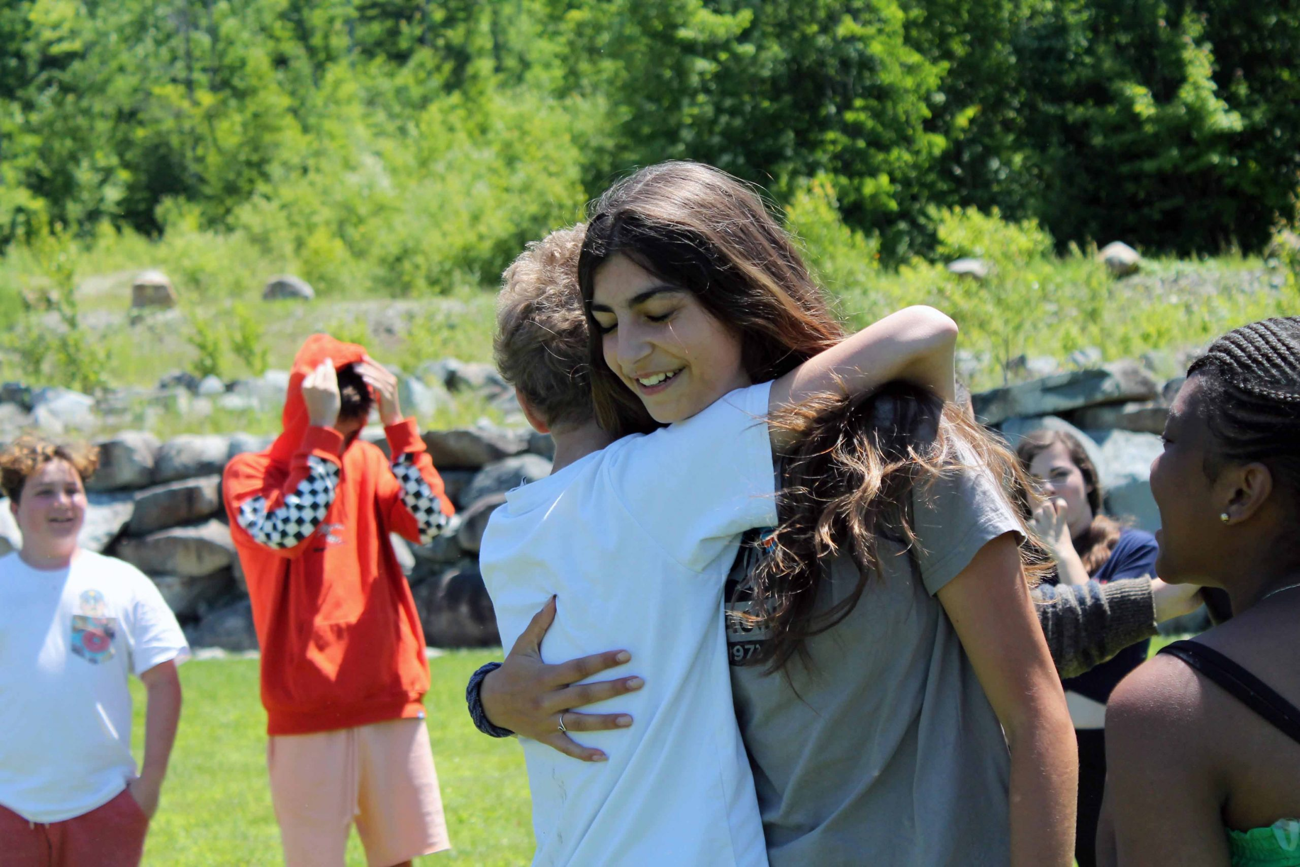 Campers hug after a competition
